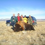 Five Hunters Posing Next to Buffalo