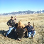Three Hunters Posing Next to Buffalo