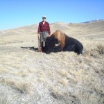Hunter Standing Next to Buffalo