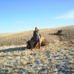 Hunter in Camo Posing Next to Buffalo