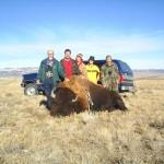 Five Hunters Posing Next to Buffalo