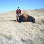 Hunter Standing Next to Buffalo