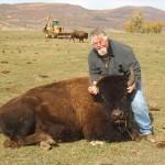 Hunter Holding Buffalo Head Up